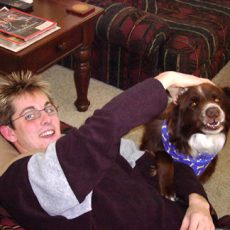 A pet owner named Austin with his brown and white boarder collie